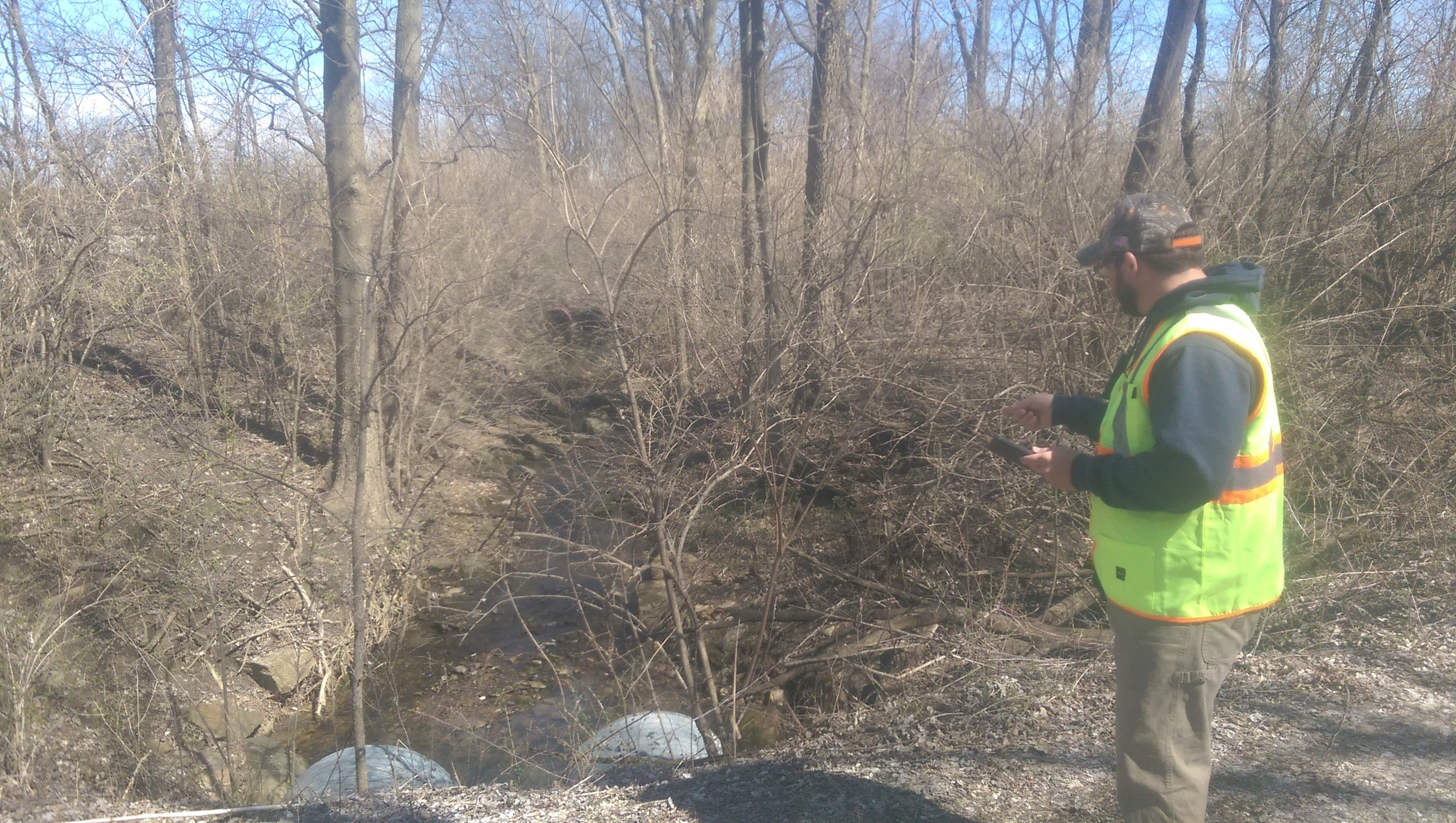 Joe using Esri's Collector app to complete a culvert inventory for LaSalle County, IL