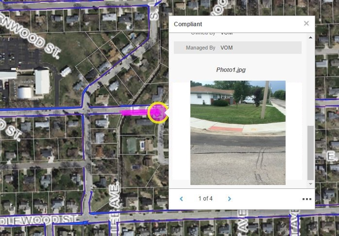 A photo of a curb ramp that was taken with an iPad using the Collector app is displayed here in the web application.