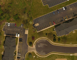 """Same area with drone imagery at 2"""" pixel resolution. Objects such as water valves, sidewalks, and pavement distresses are visable."""