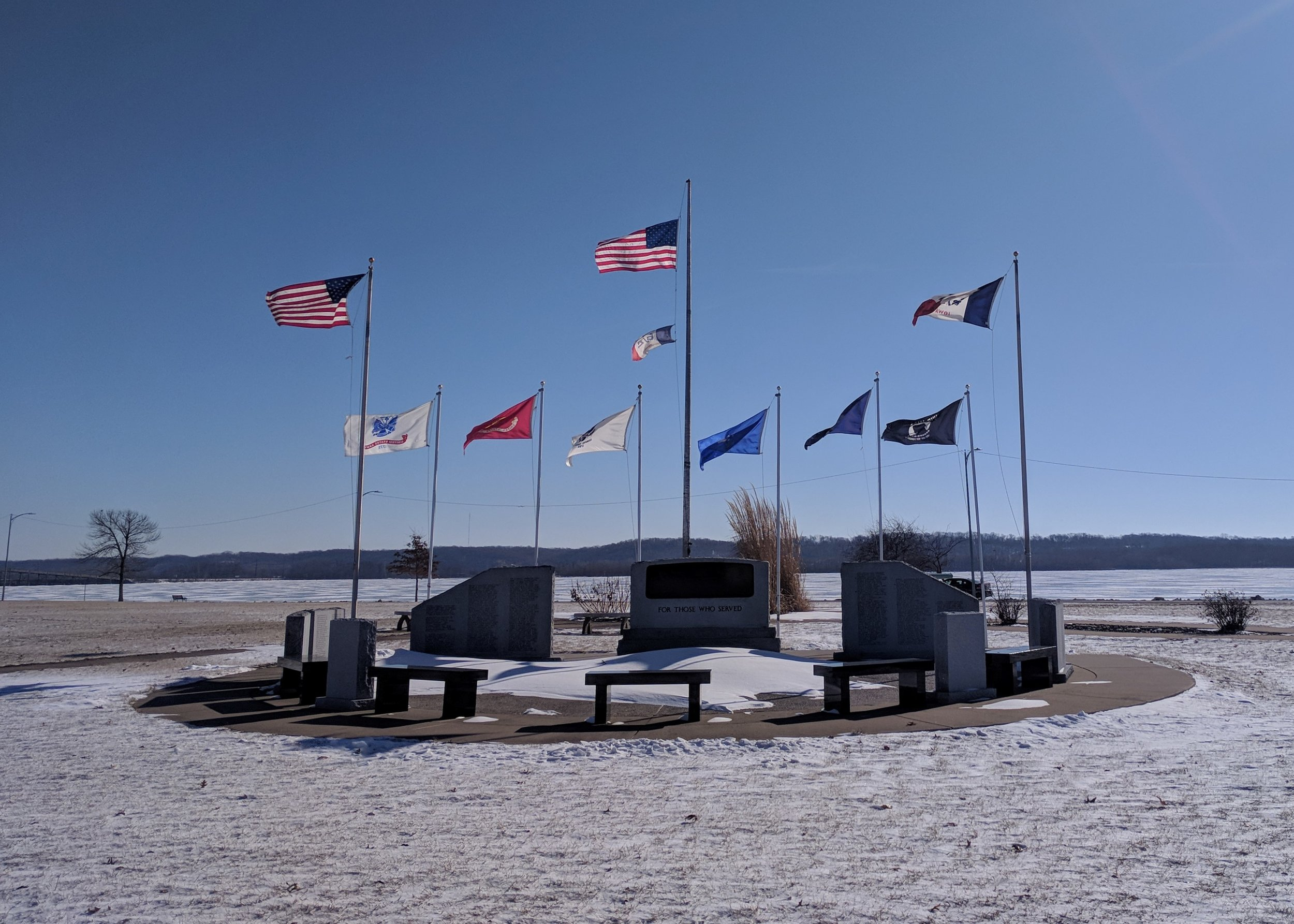 Veteran's Memorial at Riverview Park overlooking the frozen Mississippi River in Ft. Madison, Iowa.
