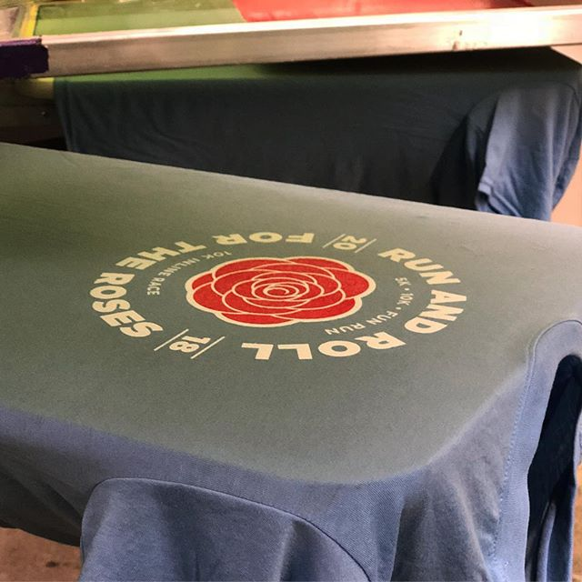 Rolling into Monday with some tees for the @rsvl_parks Run & Roll for the Roses. Nice clean design work by @e_lichtenberg. #mnrunning #screenprinting #rosevilleparksandrec