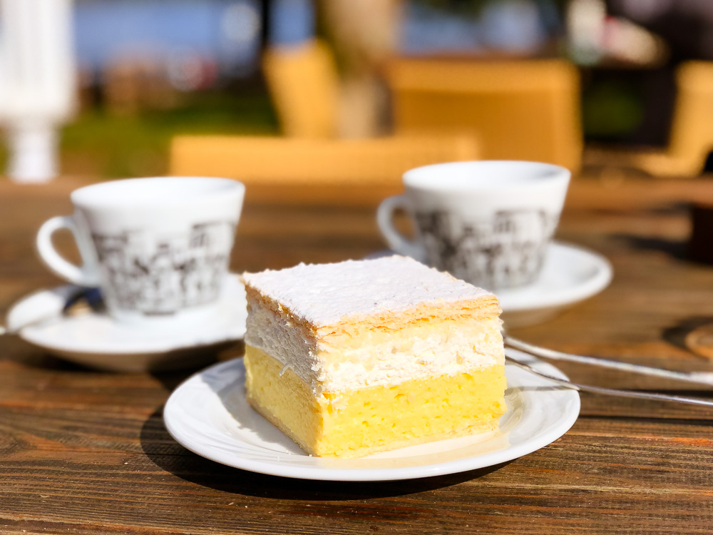 Eating delicious creme cake in Lake Bled, Slovenia