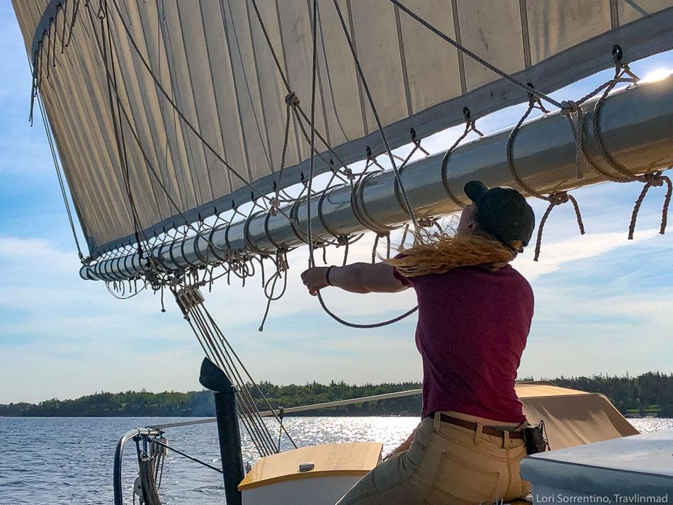 Chlöe checks the sails