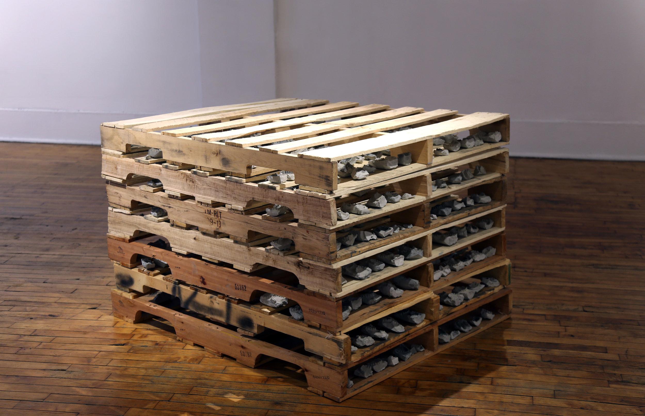 "Installation view of ""Bulk""   42""x 48""x 36""   Concrete, wood pallets"