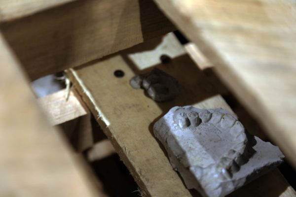 """Detail view of """"Bulk""""   42""""x 48""""x 36""""   Concrete, wood pallets"""
