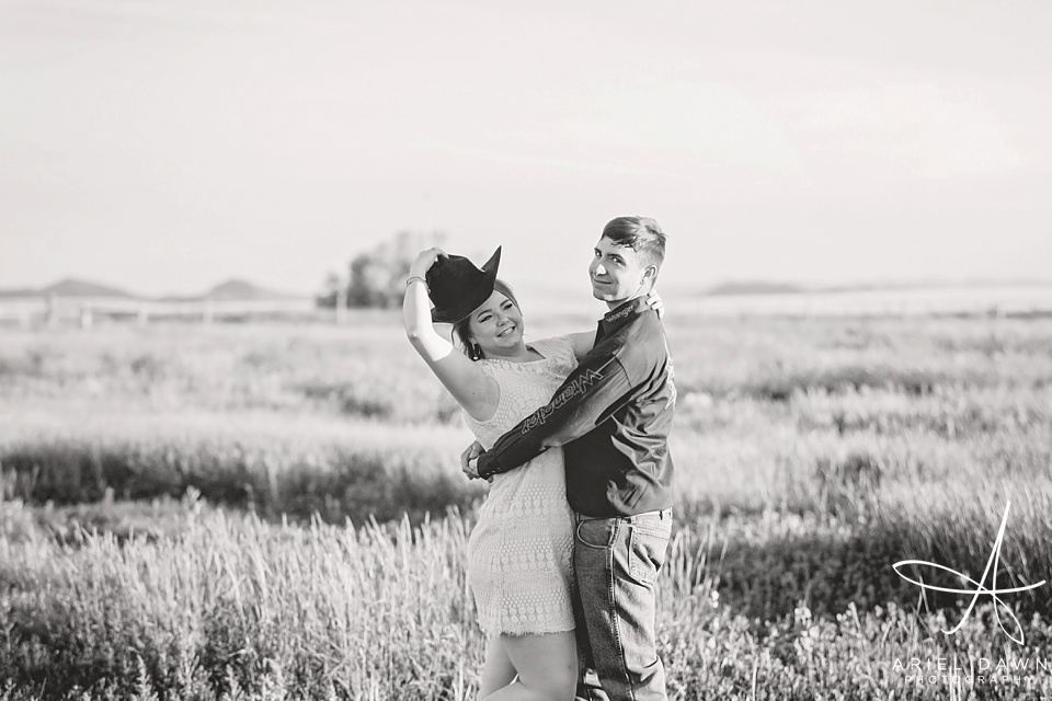 Cowboy Hat in Montana Field Engagement shoot with cowboy and cowgirl | Great Falls, Montana | Ariel Dawn Photography | www.arieldawnphotography.com | Engagement Photographer
