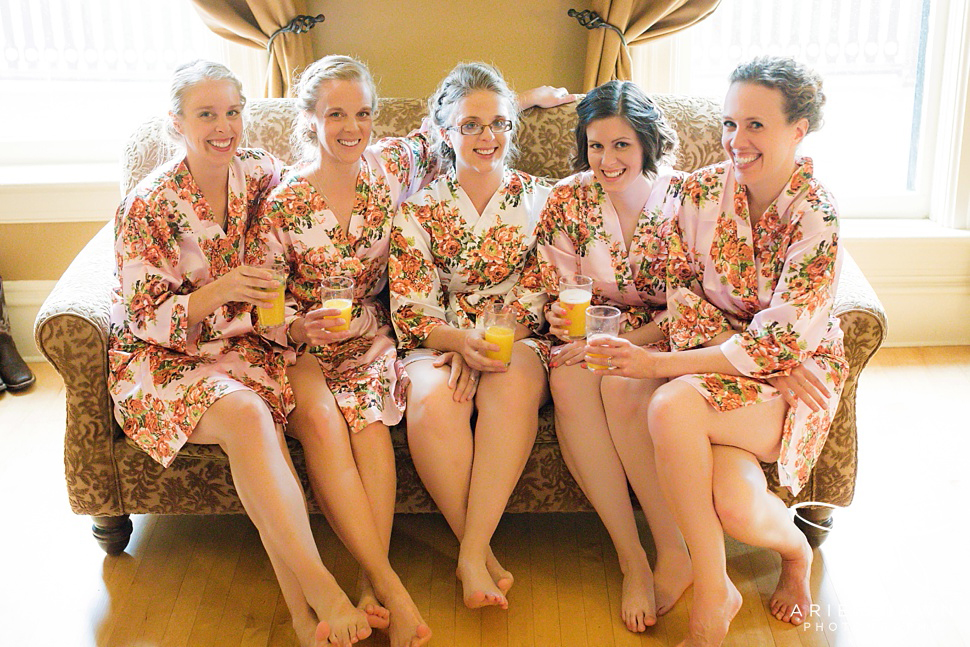 The bride and her bridesmaids shared mimosas and got ready in these amazing floral bathrobes.