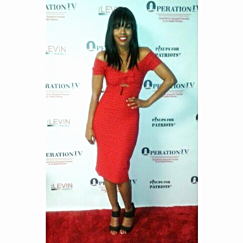 "Toni at the fundraising gala for Operation IV in ""Shame Red"" dress by Tatyana. SHOP  here  Makeup by Denika Mafnas."