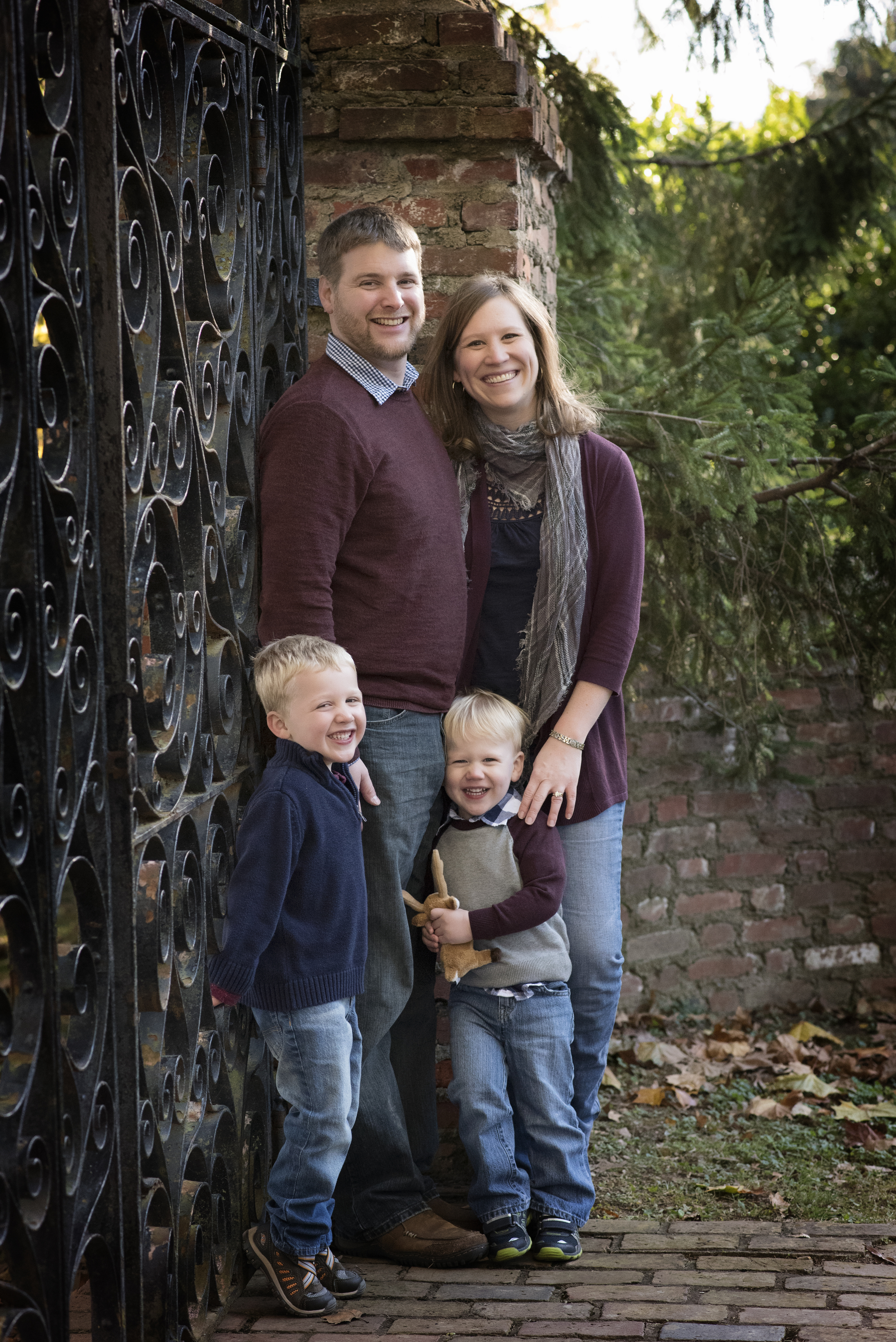 Family in front of iron gate Fall colors Kate Montaner Photography