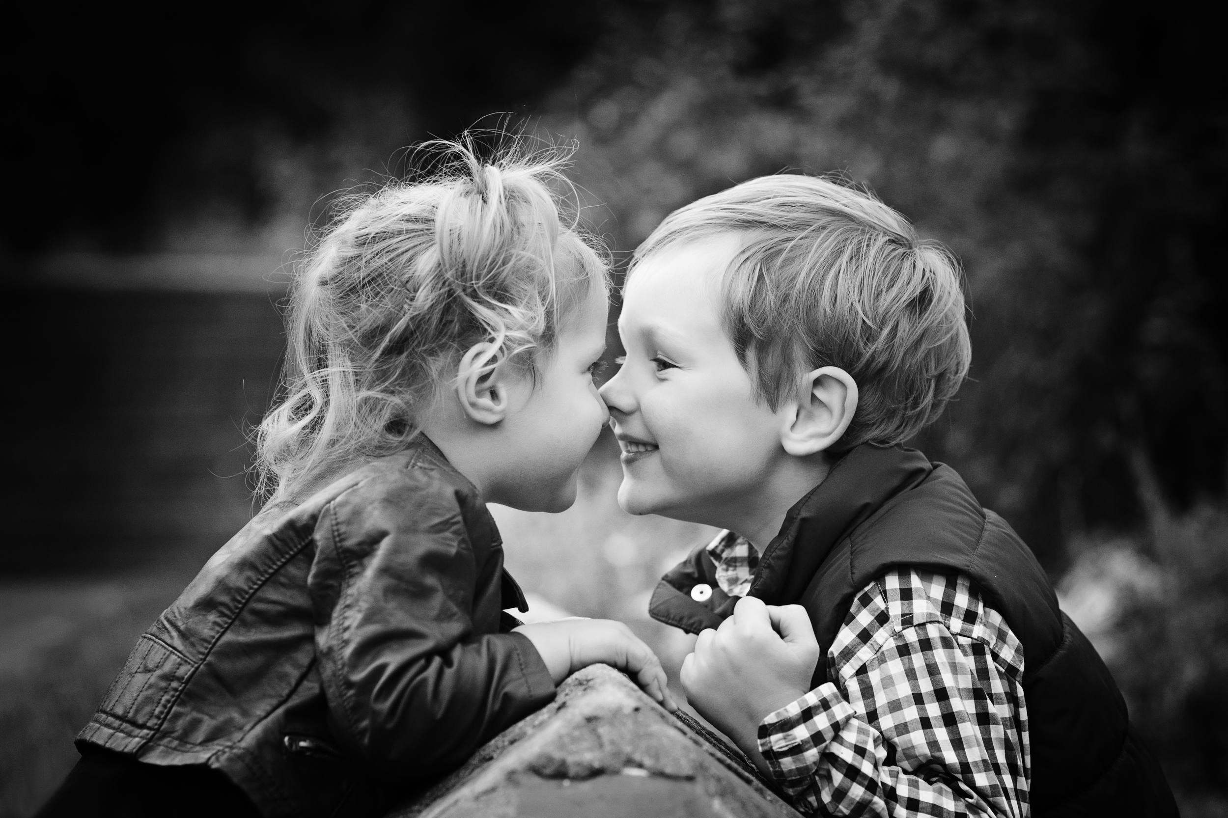 brother and sister eskimo kiss black and white lifestyle photography Kate Montaner Photography LLC