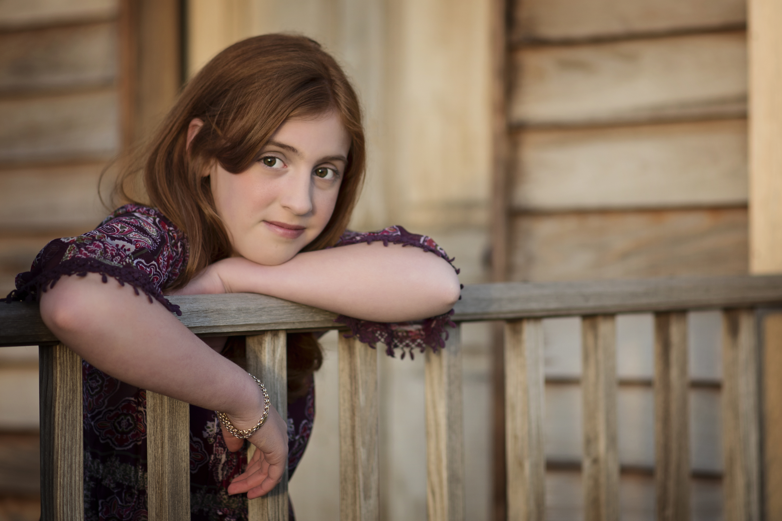 soft sunset light on young girl at barn Kate Montaner Childrens Photographer