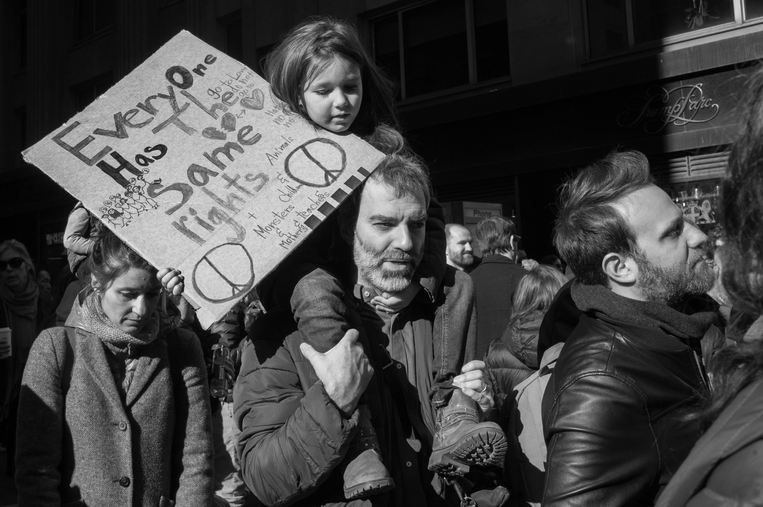 Girl and Father Protesting