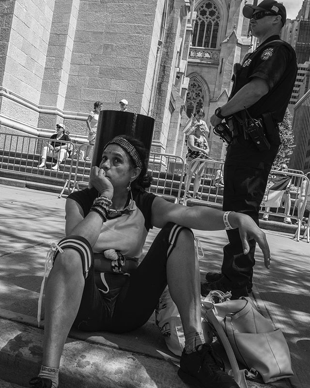 Not What It Seems! I saw this woman looking dejected and sad. She was surrounded by police officers so I thought she had been arrested. When I asked her if she was in trouble, she replied what gives you that idea; I'm just taking a break ...it's hot!  Things are not always what they seem!! . . . #eyeshotmag #bnw_life  #life_is_street  #documentingwomen  #bnw_people  #thosenewyorkstreets  #street_photography #streetphotographers  #wearethestreet #blackandwhitephotography  #bwoftheday  #magnumphotos  #streetportrait  #bnw_streetphotography #streetscenesmag #ig_streetphotography #streetportraits #bnw_people #timeless_streets #documentaryphoto  #scenes #monochromephotography #storyofthestreets