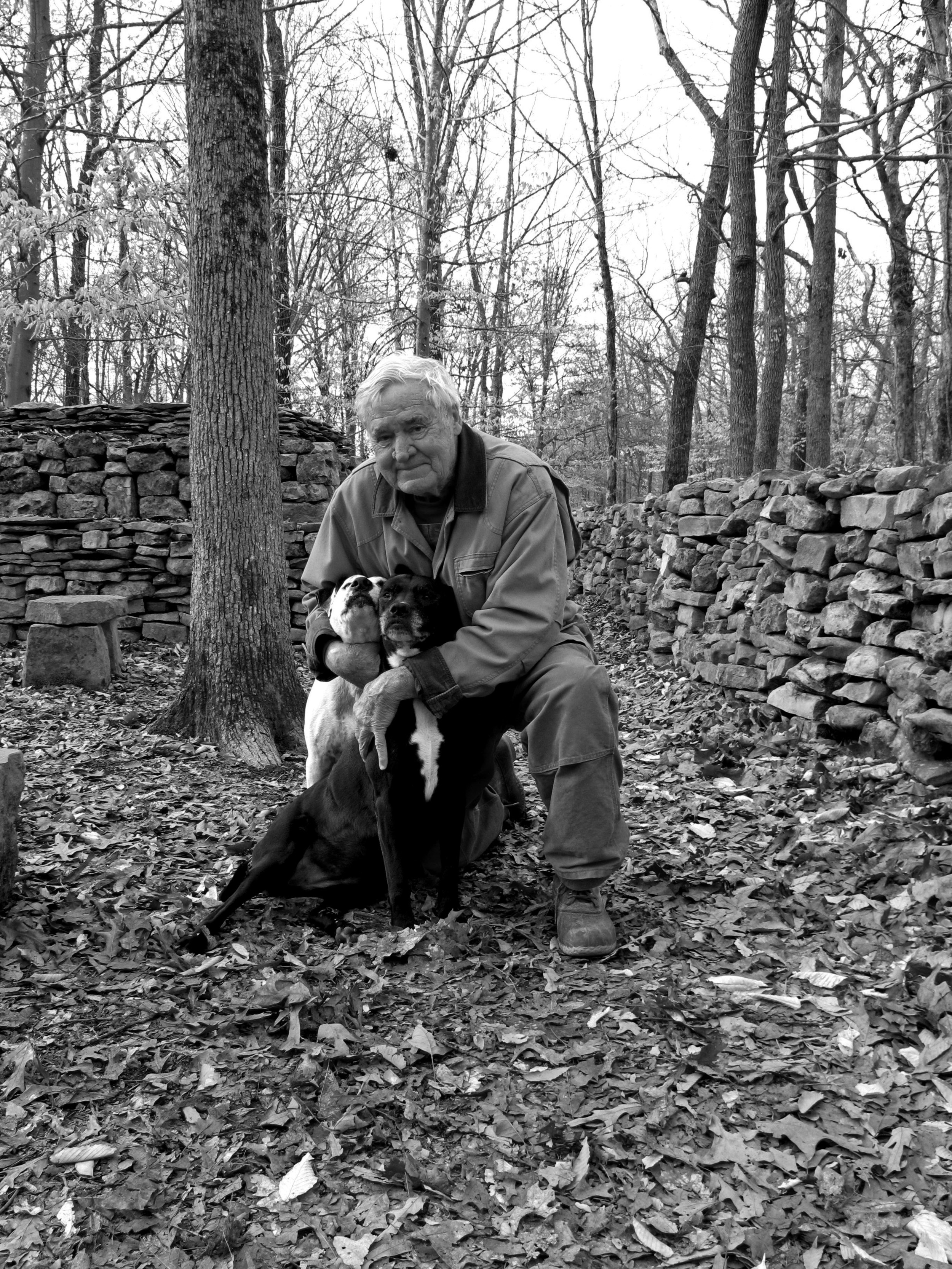 When Tom conceived of his memorial to his great-great-grandmother Te-lah-nay 25 years ago, he did not start with sketches or plans. He began by picking rocks that local farmers, clearing their land of hedgerows, had dumped by the side of the road. For 28 years has kept careful track of the truckloads, and estimates that the wall consists of 9 million pounds of stone. Each stone has been touched three times: once when he selects them and places them in his pick up truck, once at home when he unloads them into his wheelbarrow, and once when he positions each rock in The Wall. By his count, he has lifted 27 million pounds of stones, gone through three pick-up trucks, 22 wheelbarrows, and 3,900 pairs of gloves. He believes he must hold the world record for mashed fingers.