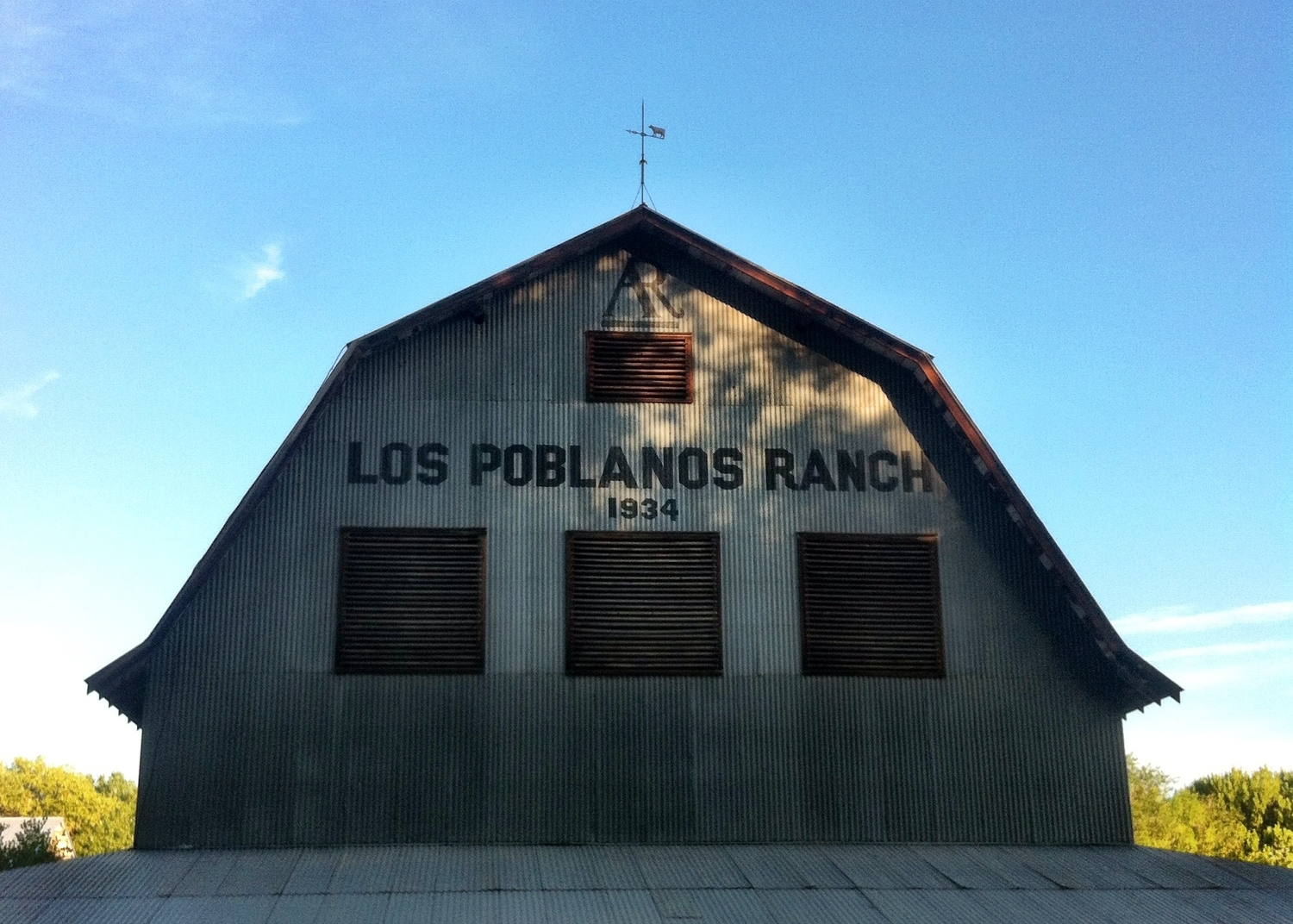Los Poblanos was inhabited by the Anasazi or ancient Pueblo Indians in the 14  th  century. The land was part of a land grant from the Spanish Crown 1716. In the 1930's Ruth and Albert Simms named their ranch Los Poblanos, of the People, where they farmed alfalfa, sugar beets, oats and corn. Home to Creamland Dairies, their 400 head of prize winning Holstein and Gurnsey cows were famed for their butterfat production, and provided much of the milk to the Albuquerque area. The Rembe family uses the old hay barn to dry the lavender that they use for their Los Poblanos spa products.