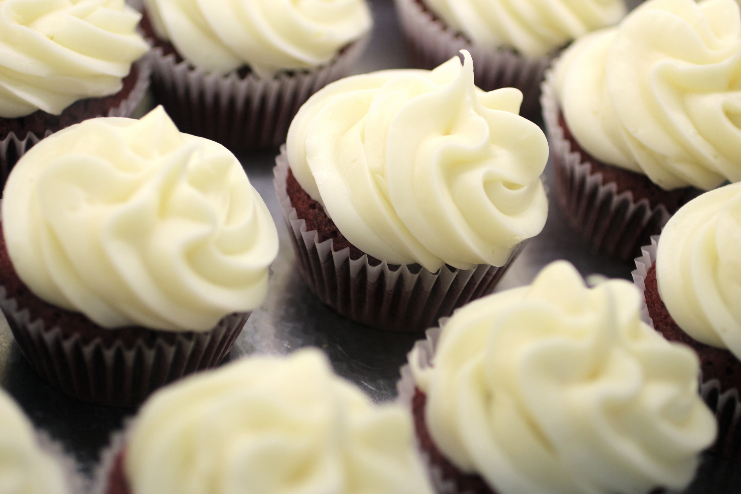 """Red Velvet"" - velvety smooth southern style red velvet cake topped with cream cheese icing."