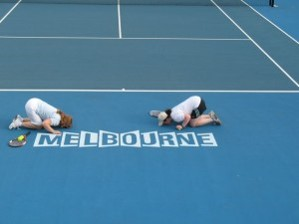 MOPT kissing Melbourne logo on court.jpg