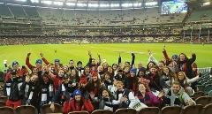 AFL tour; AFL with a local host; hosted football game; Melbourne Sports Tours