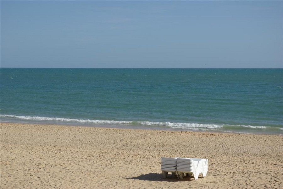 Beach Loungers and View Out To Sea