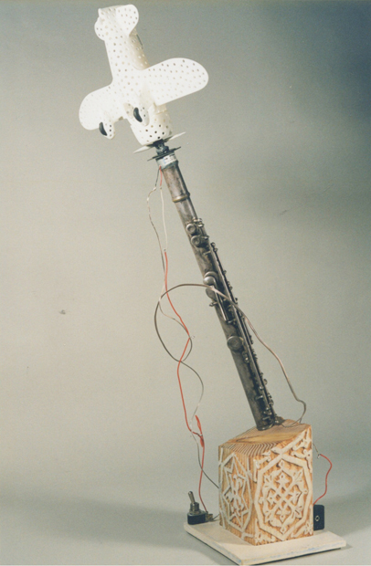 "Air Playing, 8""x20""x6"", model air plane, flute, wood & motor, 2007"