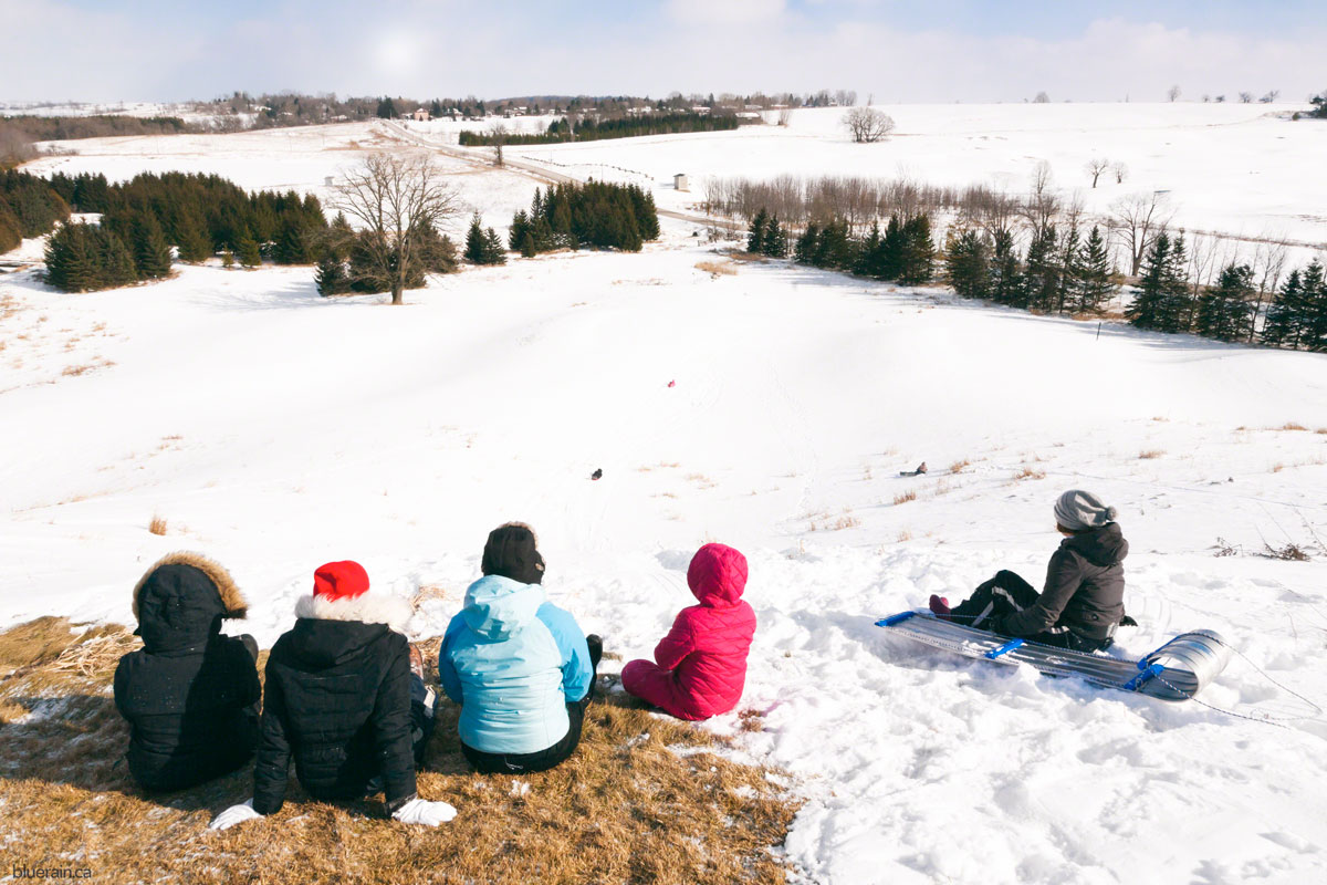 group-hill-sledding-winter-snow.jpg