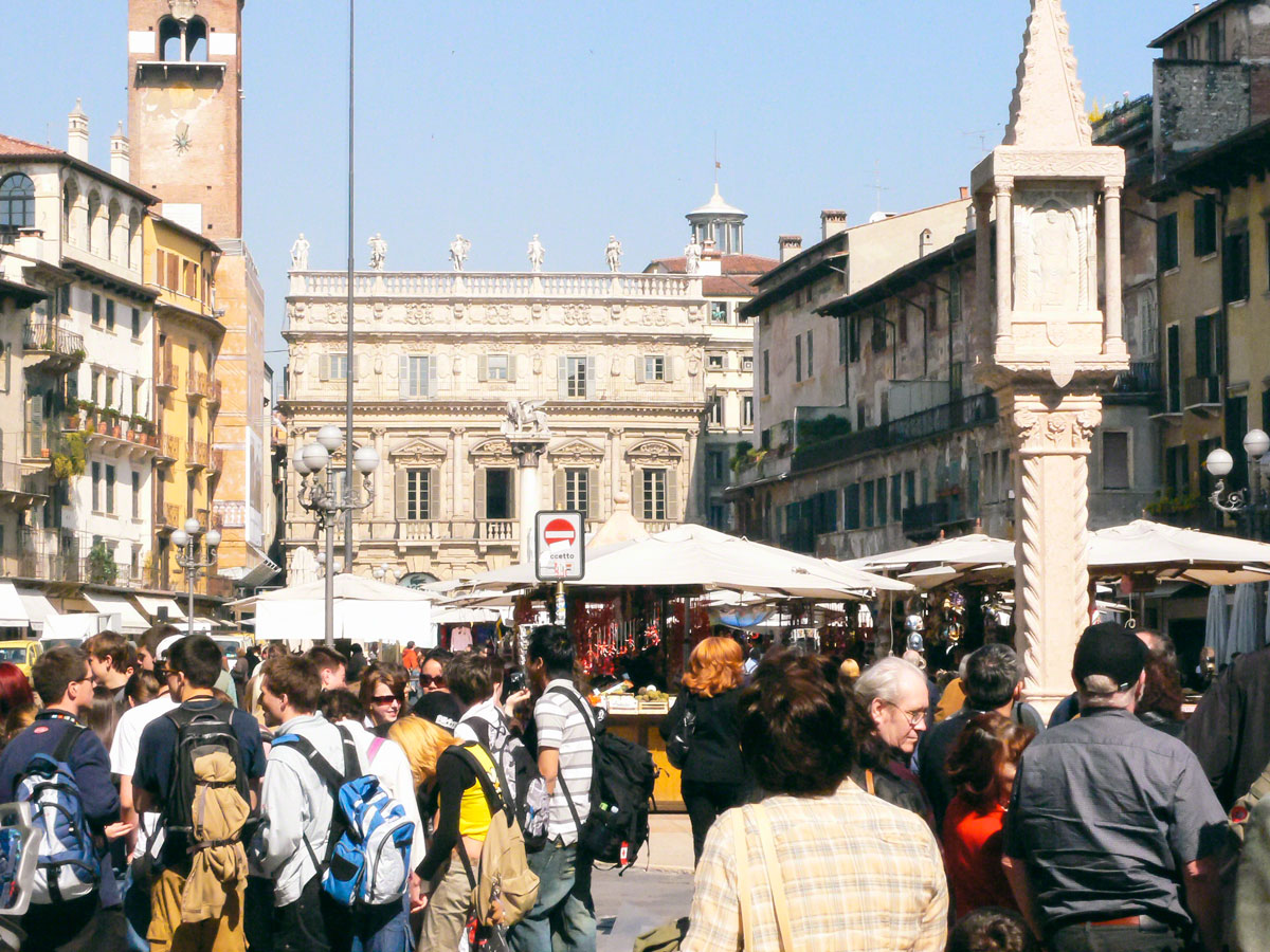 Markets and crowds in the Piazza Erbe - Verona, Italy