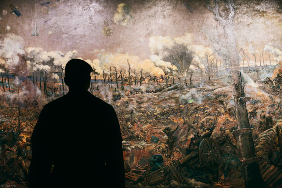A Canadian cadet views  The Battle of Courcelette  painted by Louis Alexander Weirter, which depicts the ruined French town of Courcelette during the Battle of the Somme