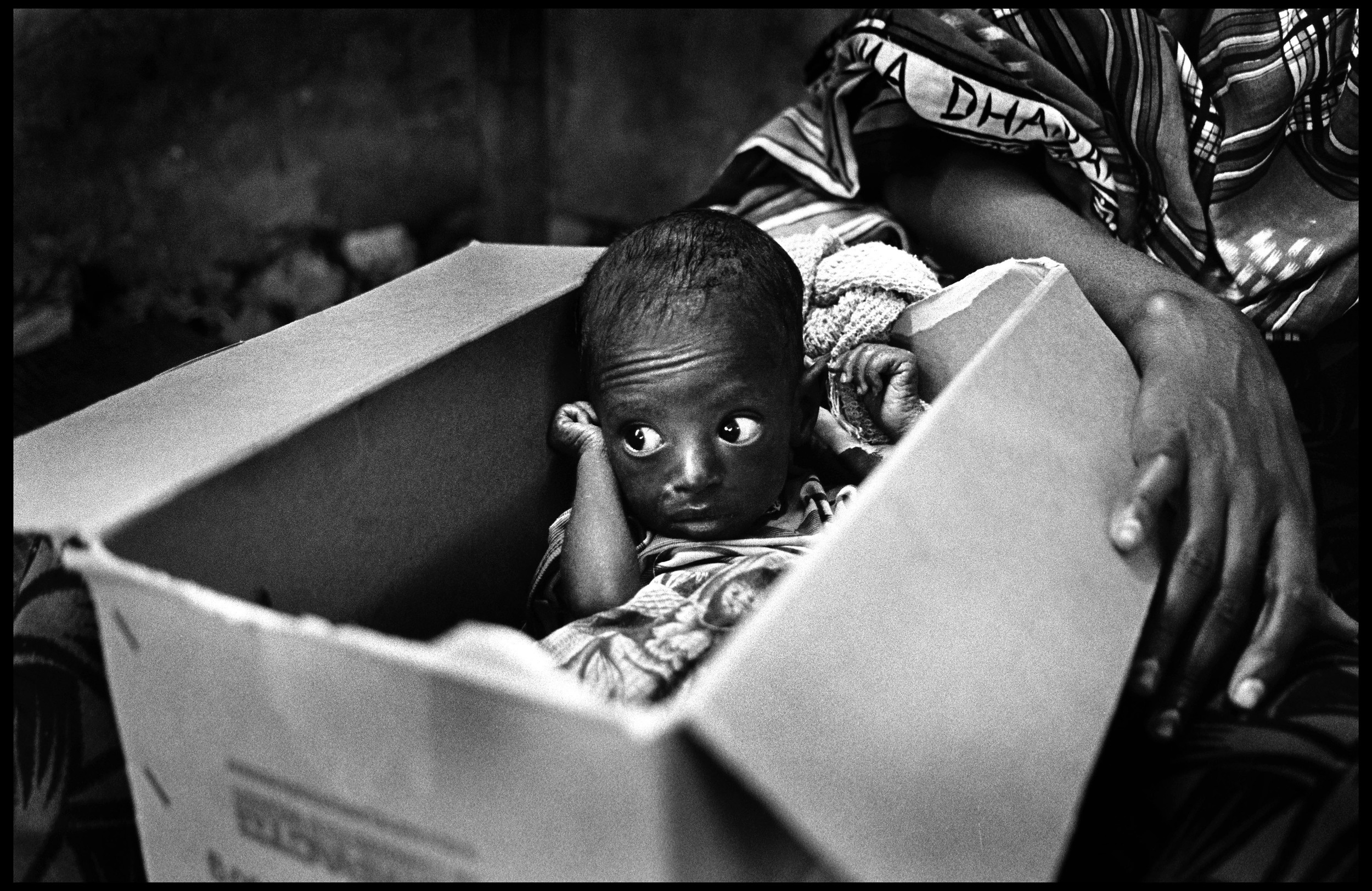 Abandoned in a box outside feeding programme, Mogadishu, Somalia