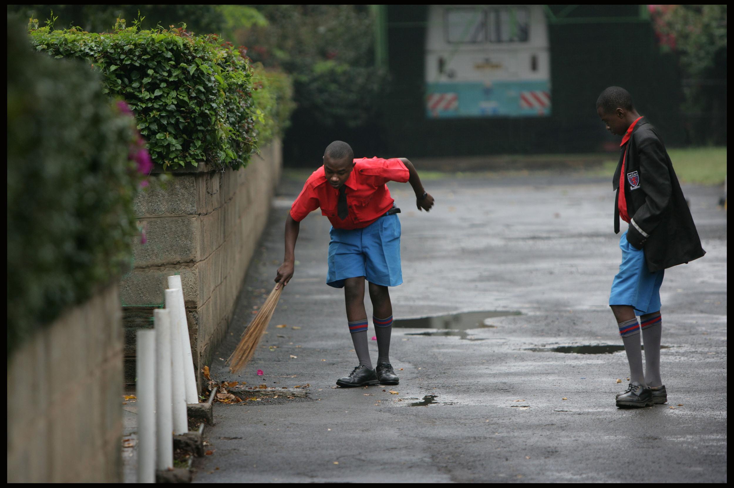 A prefect checks a boy's work, Starehe Boys Centre, Nairobi