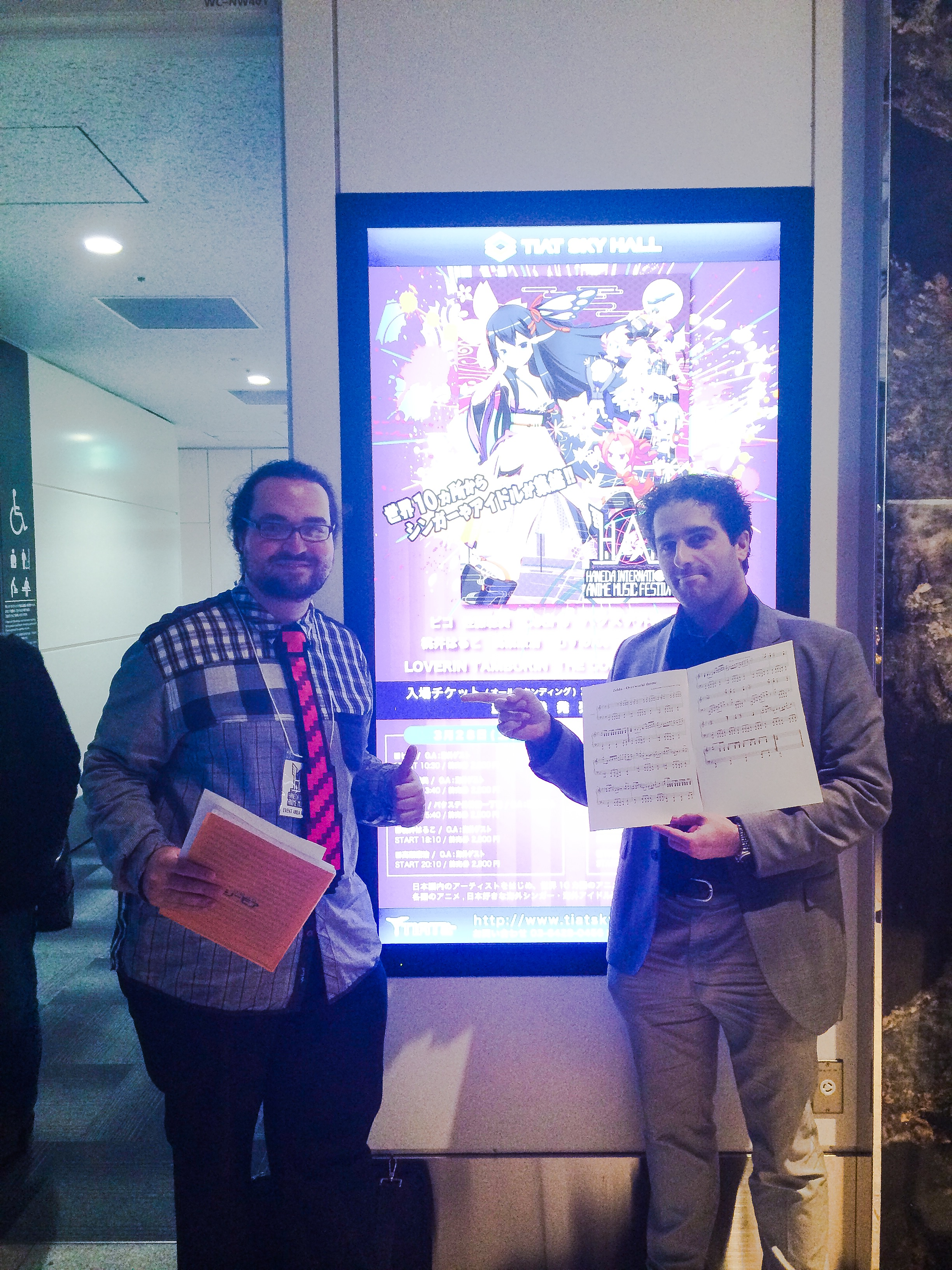 """Here with the great Gori Fater, holding the score of the well-known """"Zelda"""" game."""