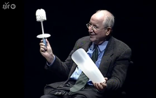 """In May 2004, I interviewed Michael Graves about his career as an architect and product designer at the Pantages Theater, Minneapolis The interview — Graves' first public appearance since becoming paralyzed and wheelchair-bound as a result of an acute infection — was subsequently broadcast on the Minnesota Channel, as a co-production of the University of Minnesota Design Institute, Twin Cities Public Television, and the Weisman Art Museum.  After discussing his architectural career,Graves spoke humorously and informatively about his product designs: the Target toilet brush, seen above, was an example of the relationship between legislative changes and design, as it followed the introduction of new limits on water used for flushing). He then spoke movingly about the illness that radically changed his life, bringing a new awareness of design as experienced by people with disabilities. """"There's an ADA act, and it's not nearly sufficient...You can't imagine how many things there are that we do, that you become dependent on. And no ramp, or lowering of the bookcase, is going to solve the question of range-of-motion. This is my world, now. The physical pain continues. I'm never without it.""""  This dialogue formed part of the series Architects Shape the New Minneapolis , jointly organized by leading Minneapolis cultural organizations including the Weisman Art Museum, the Walker Art Center, the Childrens Theater, the Minneapolis Public Library, and the Minneapolis Institute of Arts, which were all simultaneously undergoing major expansions or new building construction."""