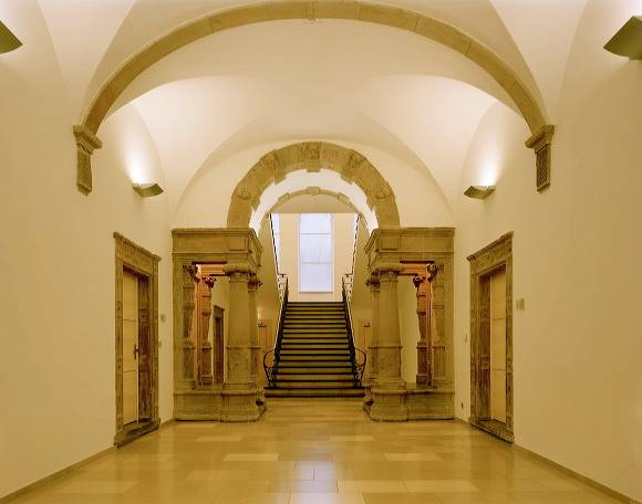 Hallway and stairs with sections of the old building
