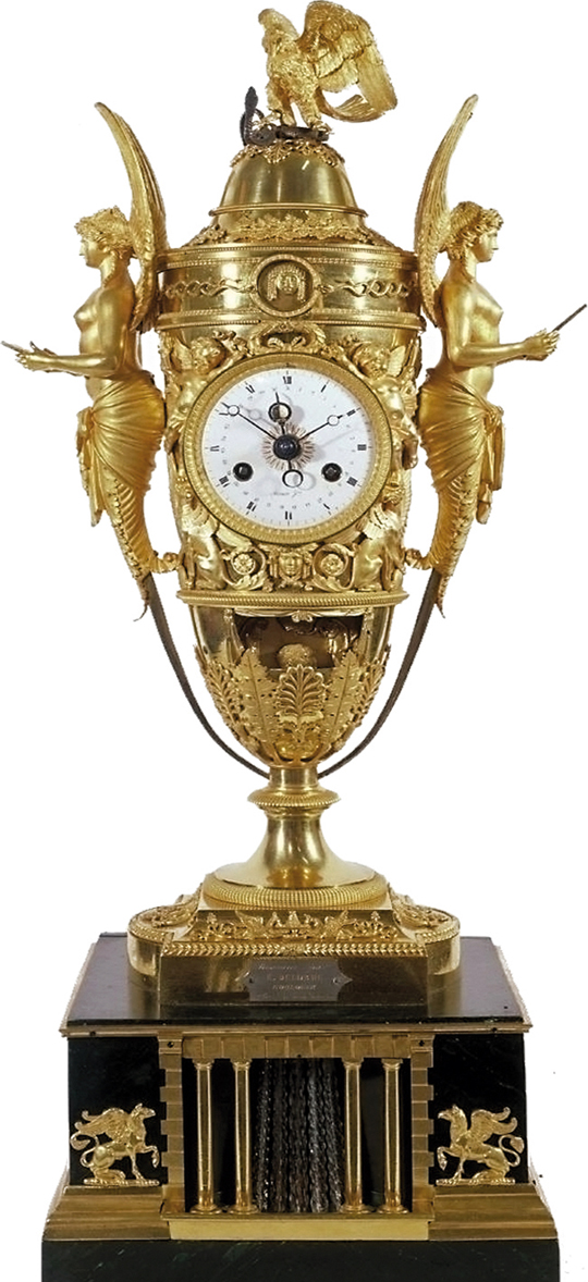 """Napoleon's timepiece in the shape of an amphora (1806), equipped with an eight-day movement, it displays the hours, minutes and date. It has a mechanism displaying the moon phases inside the day hand, by means of a tiny ivory ball. Napoleon and Josephine are crowned Emperor and Empress as soon as the music box is activated. To achieve this, an ingenious mechanism physically places the imperial crown on their heads. Bronzier Pierre-Phillipe Thomire, movement Louis Moinet."" -- Wikiwand  After many adventures, the clock was displayed at the universal exposition in Paris, 1900"