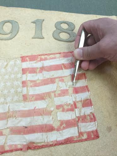 Eric then carefully pieced back the frayed, fragmented American flag.