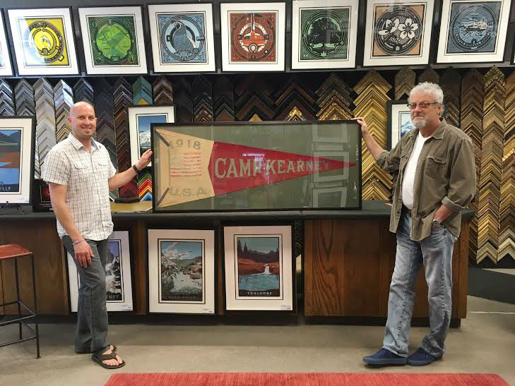 Eric (left) and our client (right) pose with the finished product. What an awesome antique find to have framed in your home!