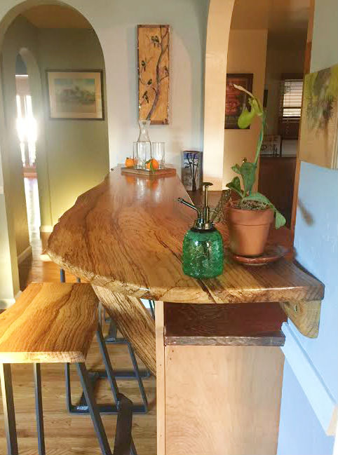 A side view of the installed table top with stools.