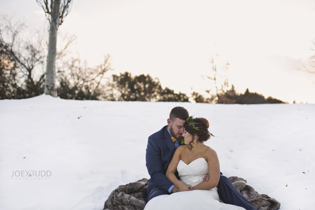 Ottawa Wedding at the Arboretum by Ottawa Wedding Photographer Joey Rudd Photography sitting in the snow winter wedding photo