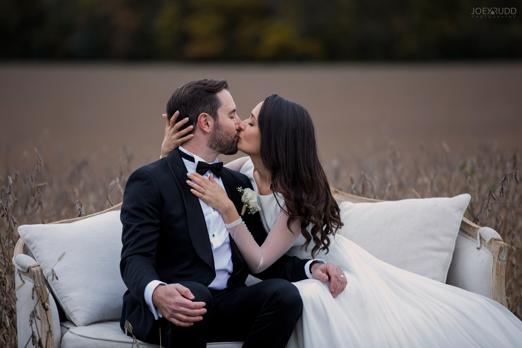 2018_10_07---Aksana-&-Mark-714TopRight.jpgEvermore Wedding, Evermore Wedding and Events, Ottawa Wedding, Almonte Wedding, Ottawa Photographer, Wedding Photography, Wedding Photographer, Joey Rudd Photography, Farm Wedding, Rustic Wedding, Barn Wedding Venue, Wedding Venue, Ottawa Wedding Venue, Almonte Riverside Inn, Candid, field wedding photo, couch in field, kissing on couch