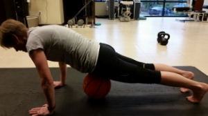 "Gillian, demonstrating her 1/2 Pushup, one of her ""love it or hate it"" exercises."