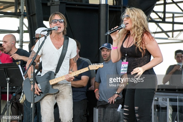 Singing a duet with Keith Urban and Nile Rodgers
