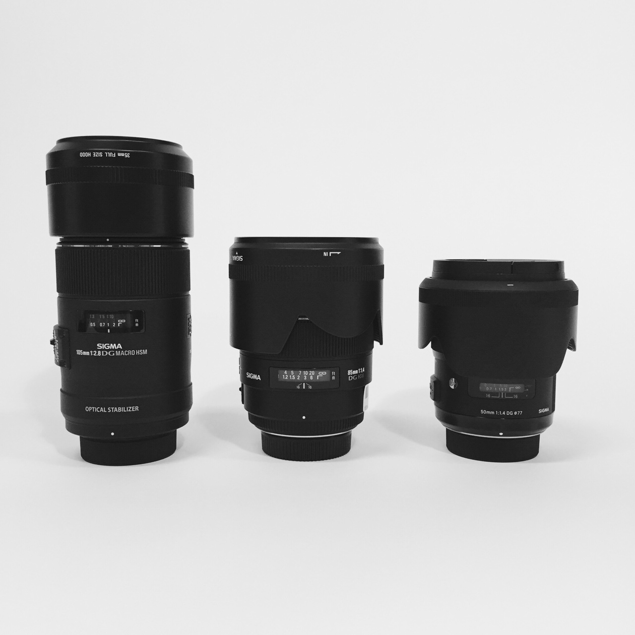 Made some new friends today. Sigma 105 macro, 85, and 50. (Don't tell the others, but the 85 is my favorite)