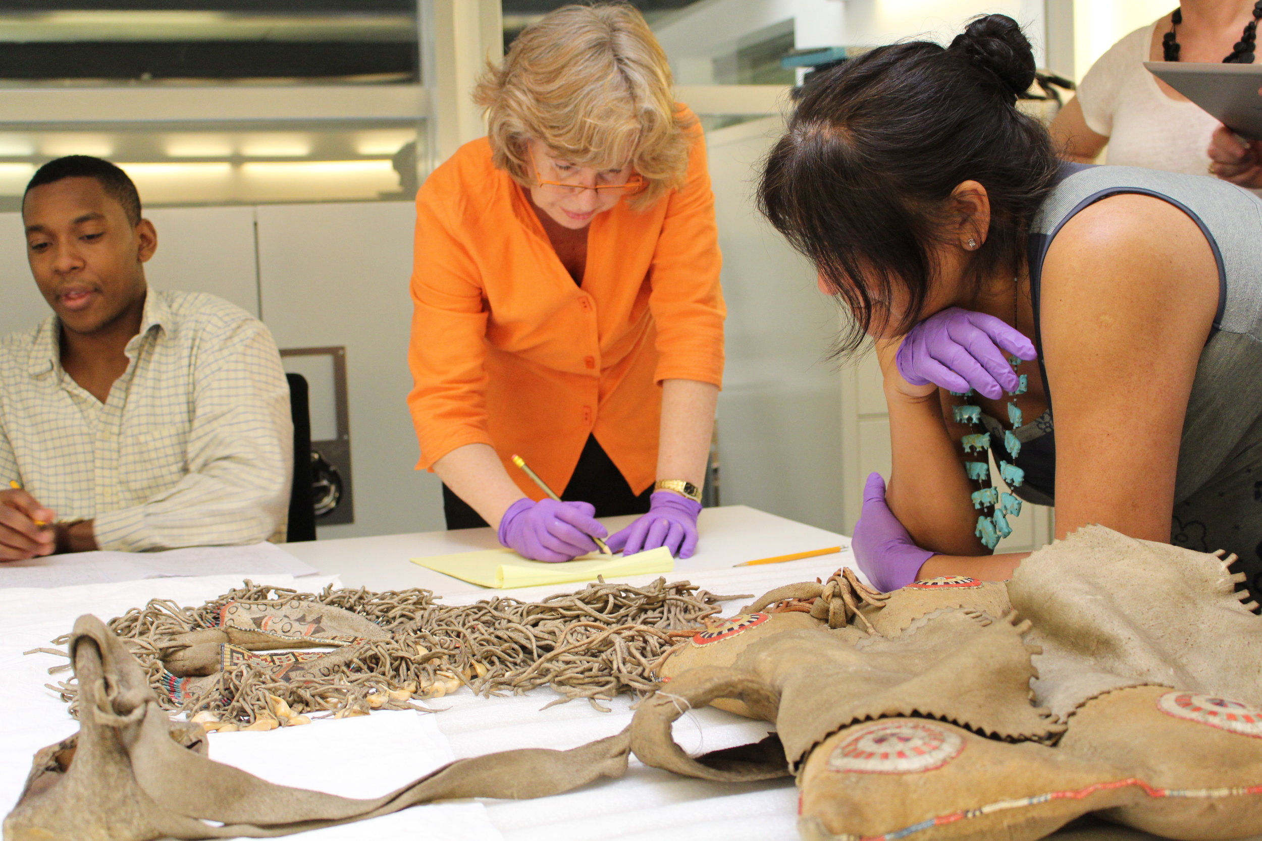 L to R: Luke Pepera (University of Oxford), Susan Berry and Judy Half study the saddle at the Pitt Rivers Museum.