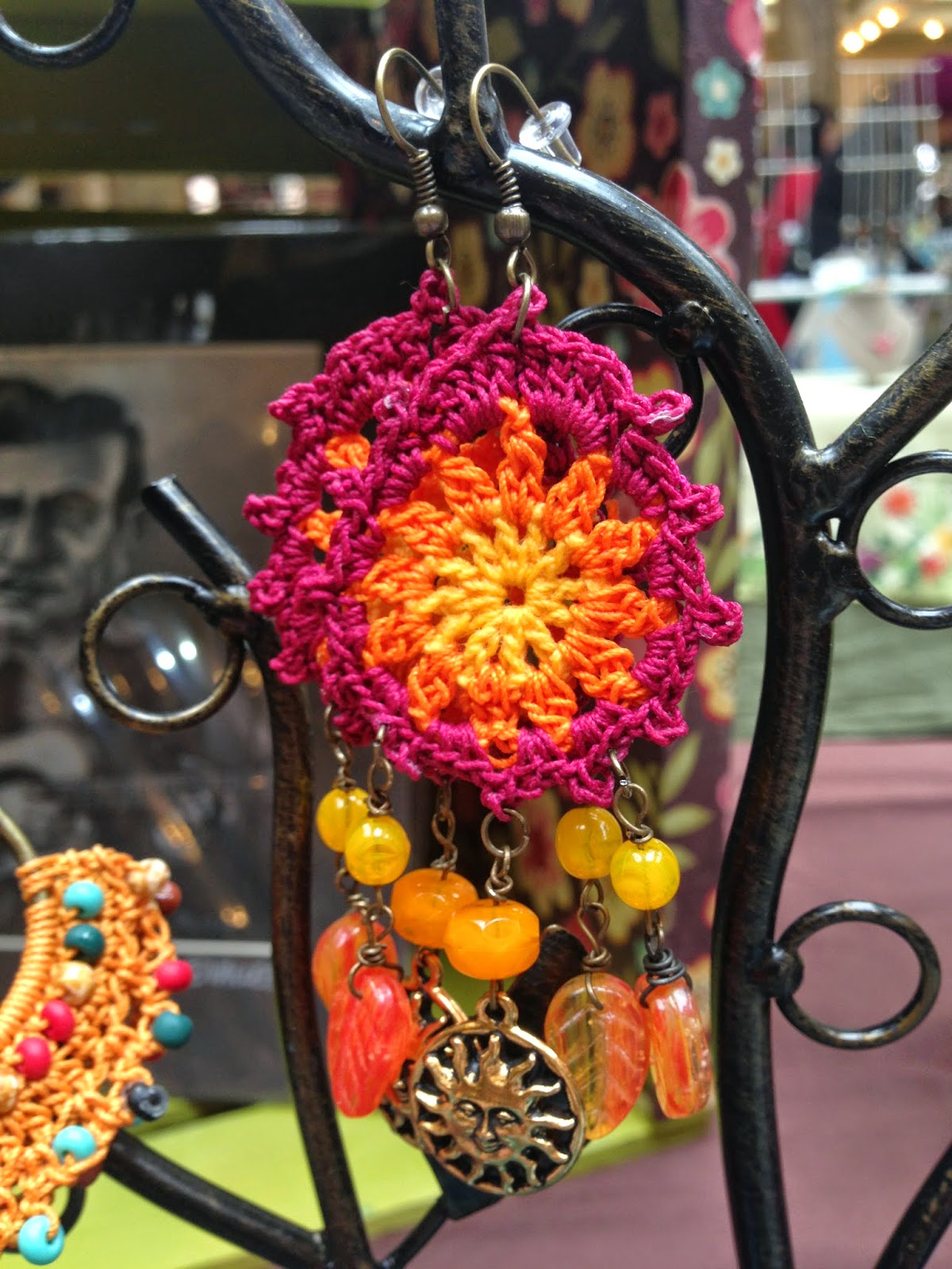 Crochet Earrings with brass sun charm and czech glass beading $24