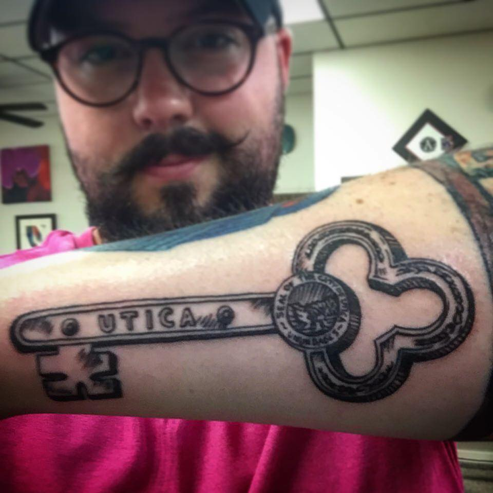 The final image on Adam's arm was created by  Inkorporated Tattoo.