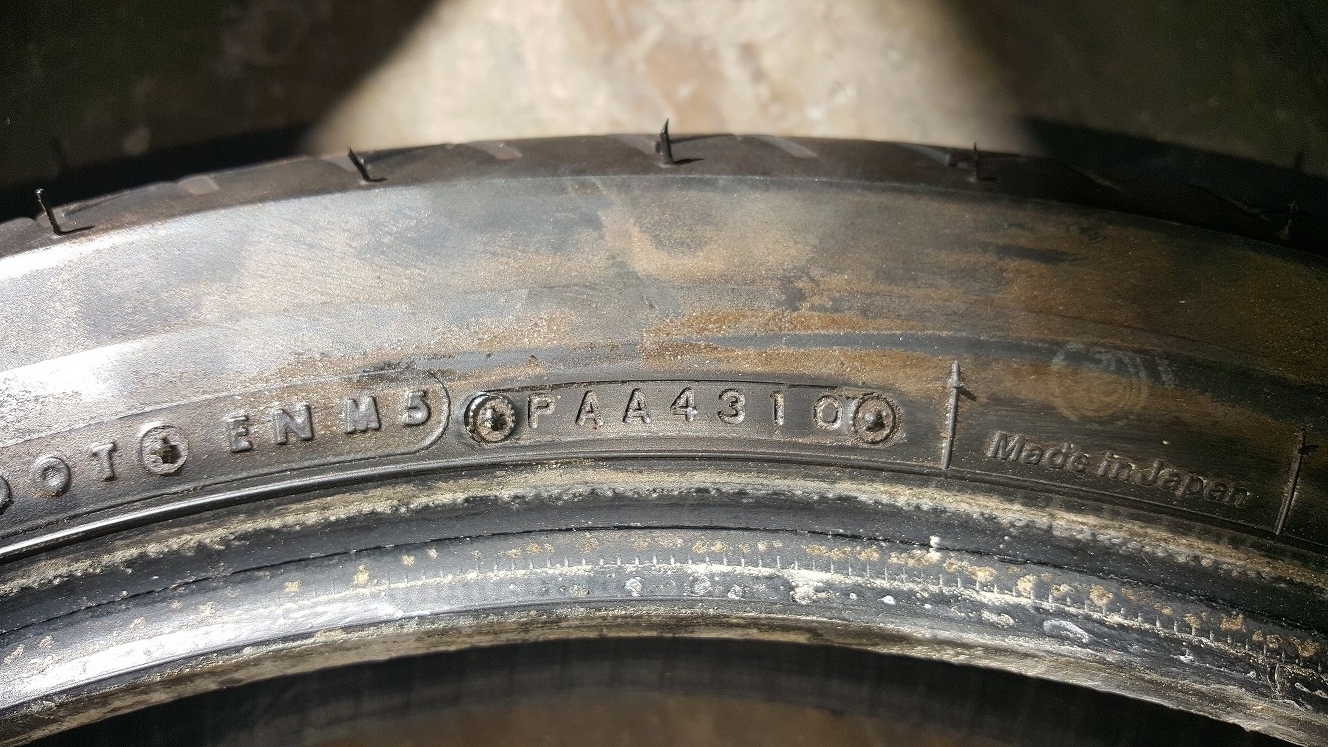 Look for this tire stamp on the sidewall of the tire. Modern tires have a 4 digit code that tells you it was manufactured the 43rd week of 2010.
