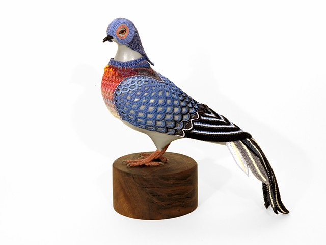 "Laurel Roth Hope,   Passenger Pigeon II,  2014, crocheted yarn, handmade pigeon mannequin, walnut stand, 11"" H x 10 ½"" D (beak to tail) x 4"" W,  Base: 5 in diameter."