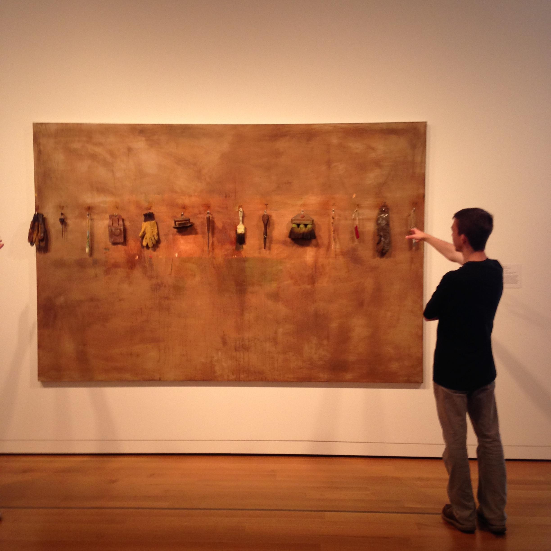 Connor Duggan examines a piece byJim Dine.