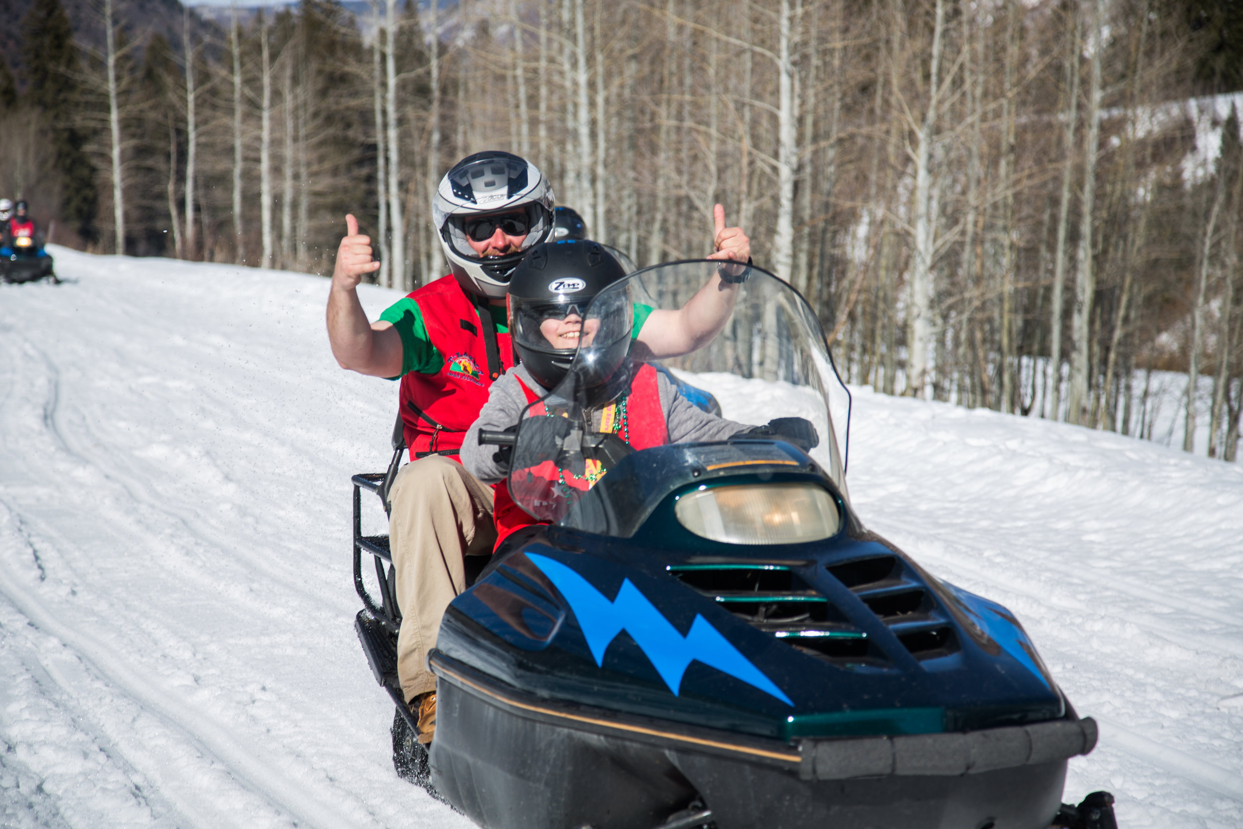 T Lazy 7 Ranch in Aspen provides snowmobile rides for the kids every year!