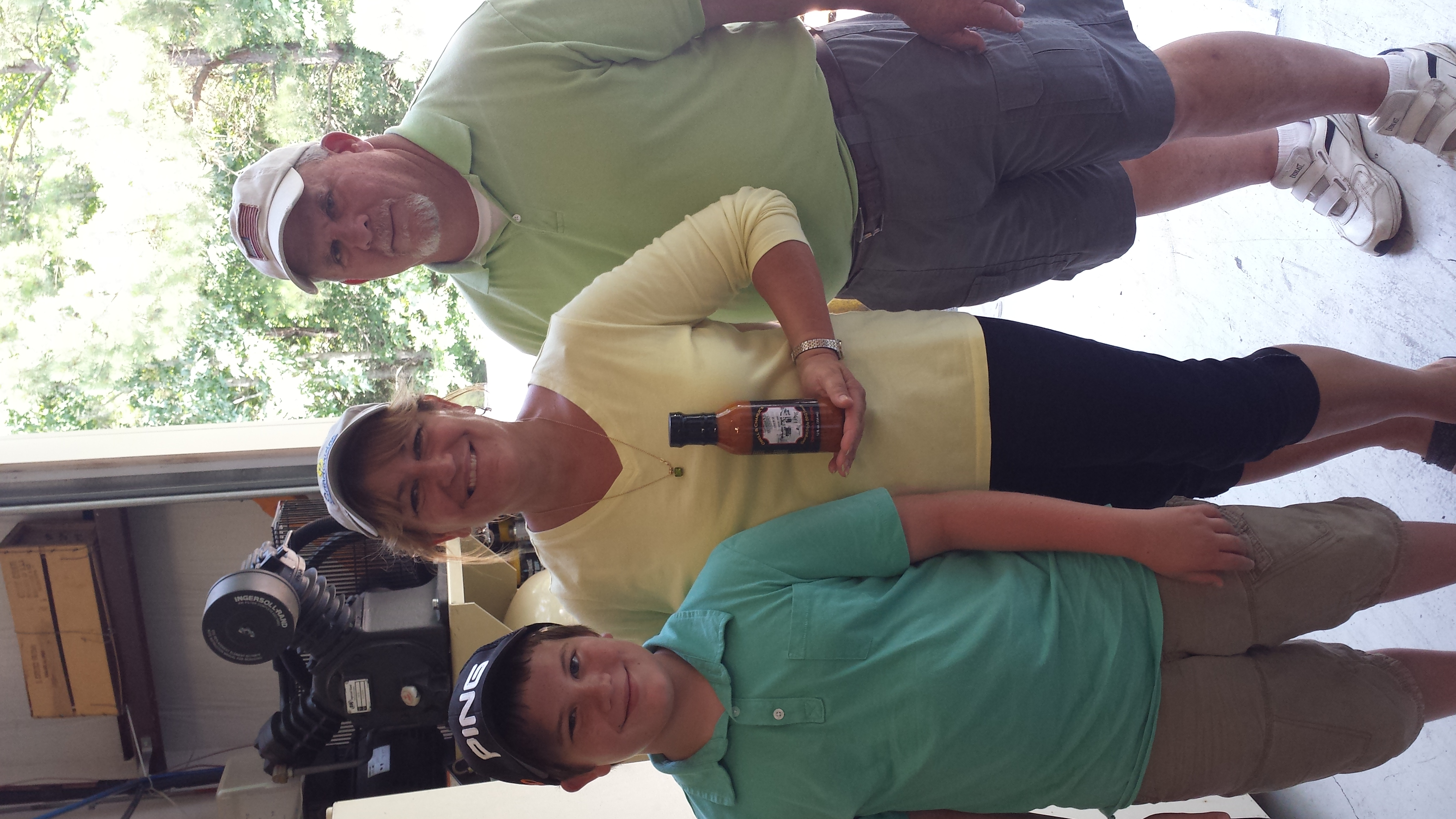 Sue Patton with Tom, her husband, & Cody, her grandson, with our first bottle of Obell & Charlie's Georgia Style BBQ Sauce hot off the line. It was an exciting day!
