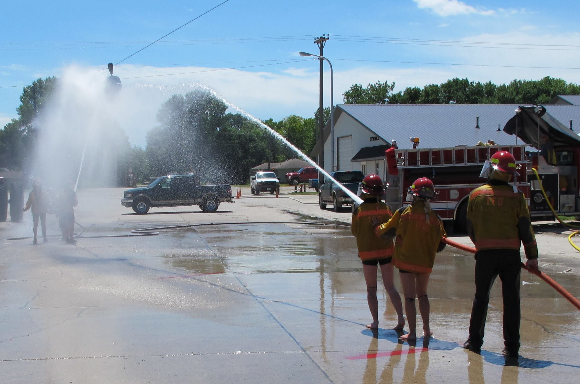 Fire departments set up hose battles for blasting a beer keg down a cable.